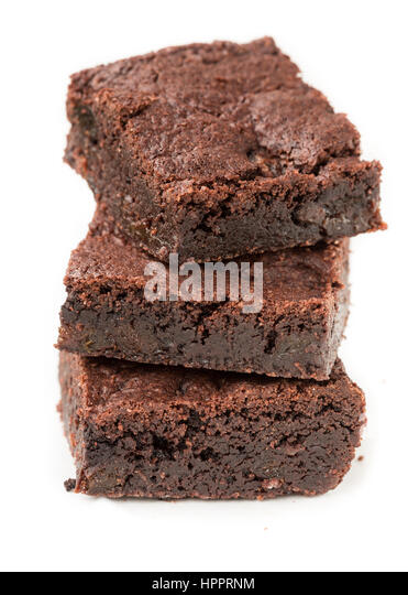 Stack of Chocolate prune Brownies on white background - Stock Image