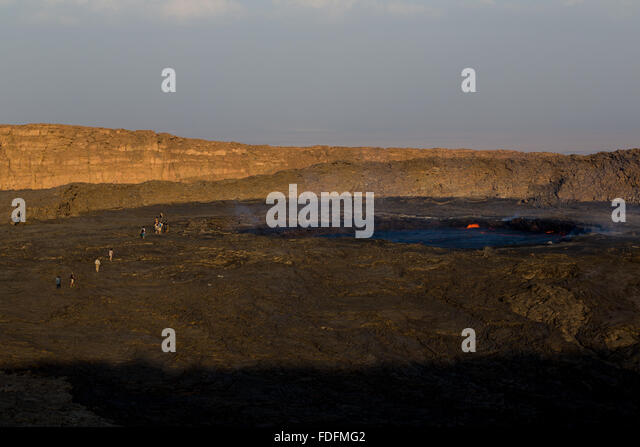 Day-trippers rush to take a look at Erta Ale's lava lake before descending the mountain a few hours later - Stock Image
