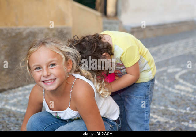 two children playing - Stock Image