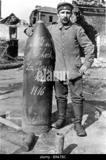 Historical image, soldier standing beside a bomb, ca. 1916 - Stock Image