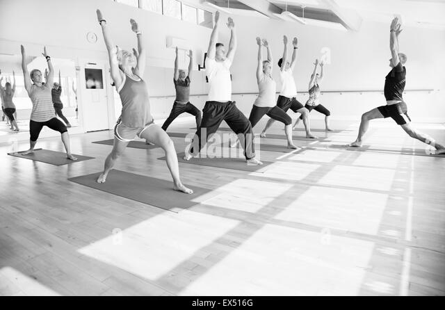 Group of People at Yoga Class - Stock Image