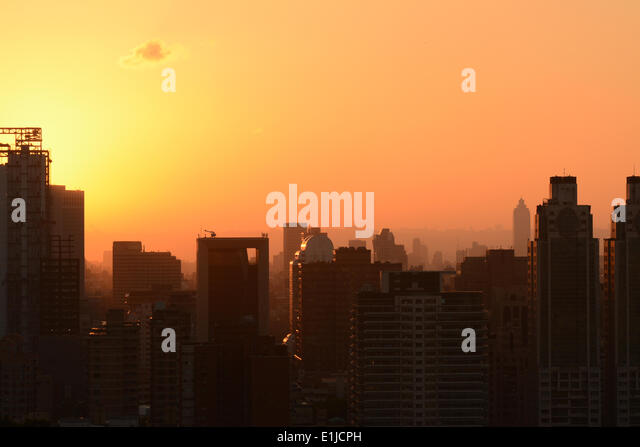 Sunset cityscape - Stock Image