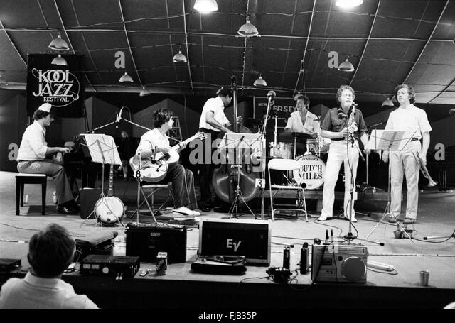 Bob Wilber on stage at the Kool Jazz Festival in Stanhope, New Jersey, June 1982. With him are Butch Miles on drums, - Stock Image