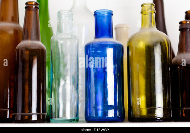 Colourful glass bottles - Stock Image