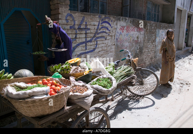 A vegetable vender goes door to door selling vegetables in Dhaka Bangladesh - Stock Image