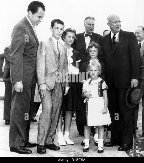 President Eisenhower's grandchildren see him off on his trip the East Asia. L-R: Vice Pres. Richard Nixon; grandson - Stock Image