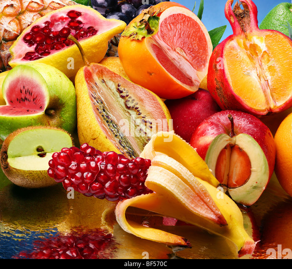 Concept photo of the modified fruits on a mirror - Stock Image