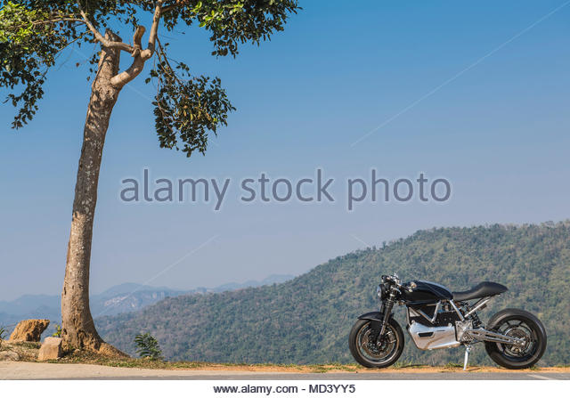 Motorcycle parked in front of scenic view, Khao Yai national park, Prachin Buri, Thailand - Stock Image