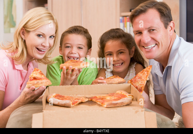 Family Eating Pizza Together - Stock Image