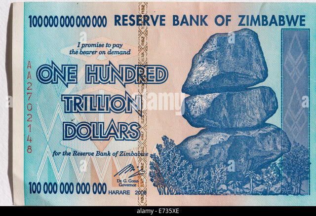 A Zimbabwean one hundred trillion dollar note as was in circulation in 2008 during the period of hyper-inflation - Stock Image