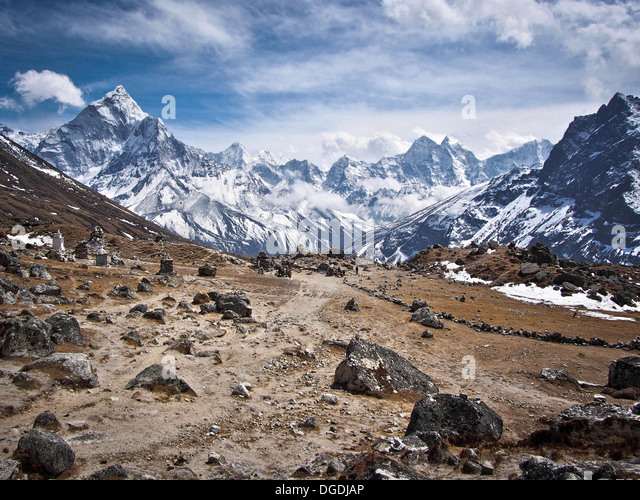 Ama Dablam (left) and other peaks along the Everest Base Camp Trek. - Stock Image