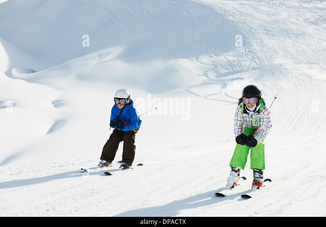 Brother and sister skiing, Les Arcs, Haute-Savoie, France - Stock Image
