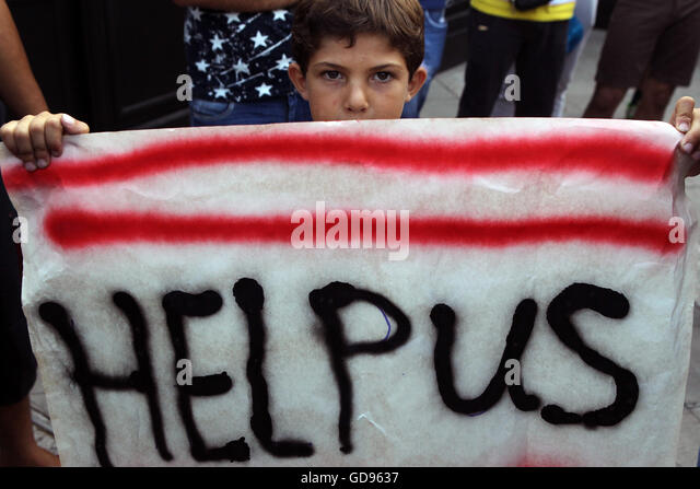 Athens. 14th July, 2016. A boy takes part in a protest in central Athens, Greece on July 14, 2016. About 1,000 people - Stock Image