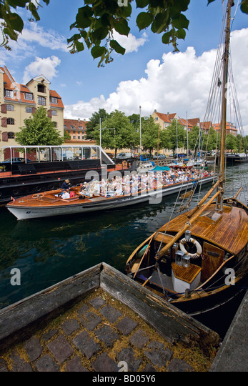 Sightseeing boat in Christianshavn canal, Copenhagen, Denmark, Europe - Stock Image