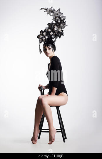 Artistic Fancy Woman wearing Extraordinary Fancy Headdress - Stock Image
