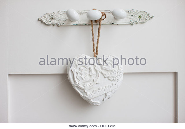 Hearts hanging on wall - Stock Image