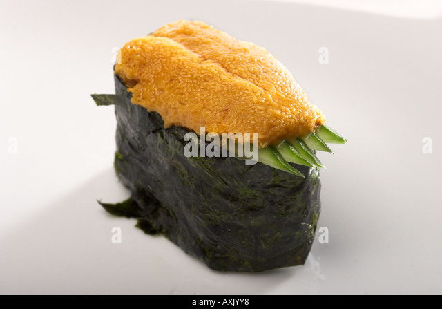 uni sushi with seaweed vegetable food meal appetizer ethnic from Asian cultural green brown fresh - Stock Image