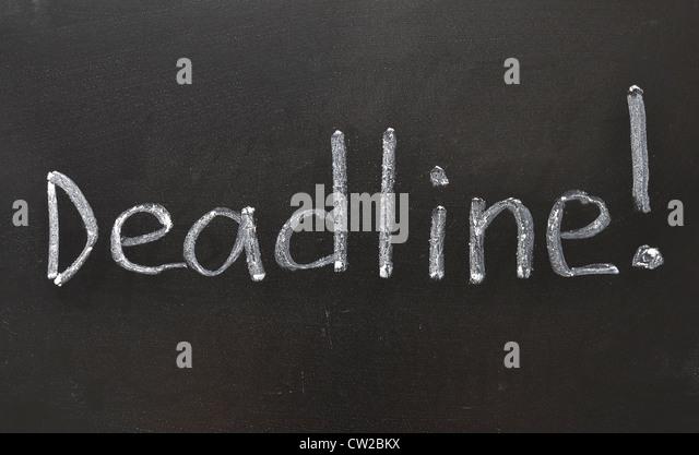 handwritten Deadline with Exclamation point on the school blackboard - Stock Image