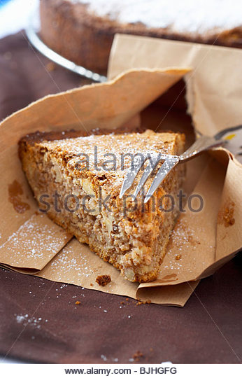 Piece of Californian nut pie in paper bag - Stock Image