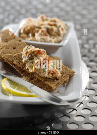 Salmon spread on crackers - Stock Image