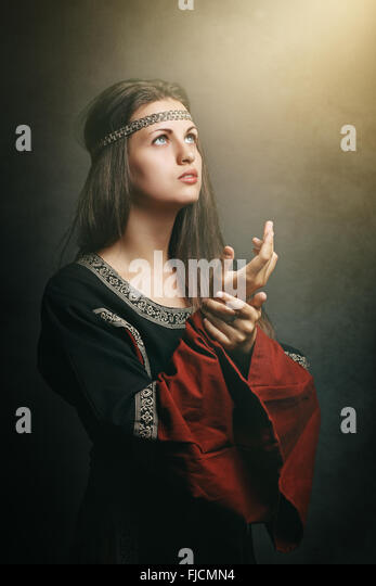 Medieval  woman with eyes to soft holy light. Historical and religion - Stock-Bilder