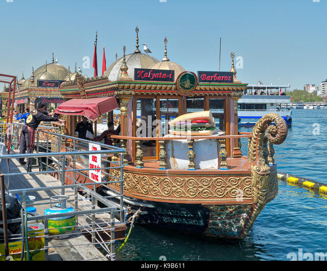 Istanbul, Turkey - April 25, 2017: Traditional fast food bobbing boat serving fish sandwiches at Eminonu with chefs - Stock Image