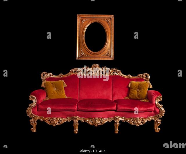 Red baroque sofa, isolated - Stock-Bilder