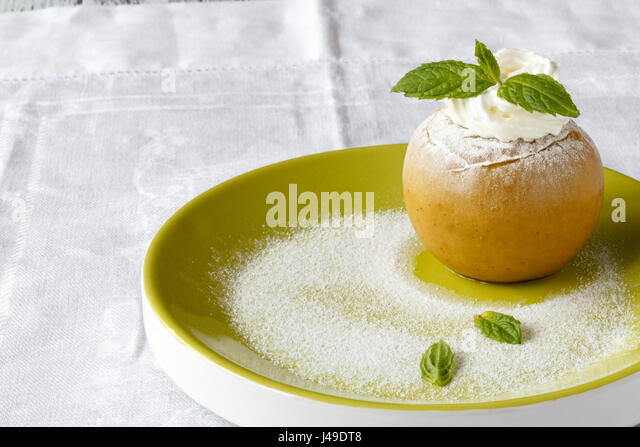 Baked apple and pear dessert with ice cream - Stock Image