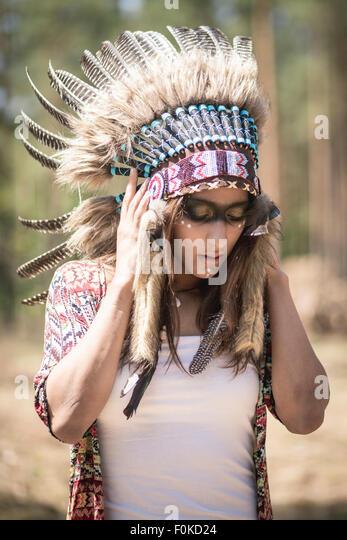Young woman masquerade as an Indian - Stock Image