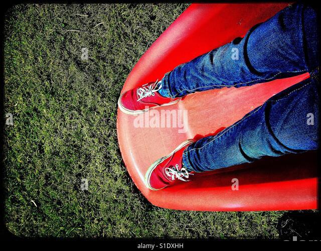 Small child on slide - Stock-Bilder