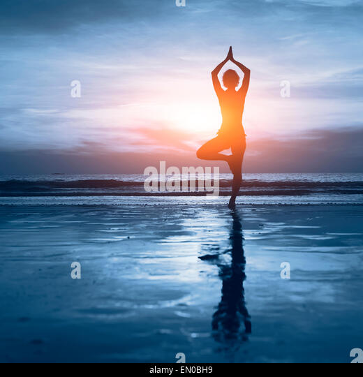 wellness concept, beautiful silhouette of woman practicing yoga - Stock-Bilder