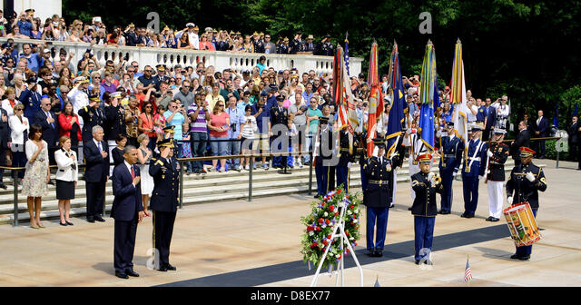 US President Barack Obama stands at attention during the playing of Taps at the Memorial Day ceremony at the Tomb - Stock Image