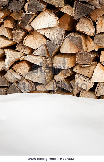 woodpile after snowing Copy space - Stock Image