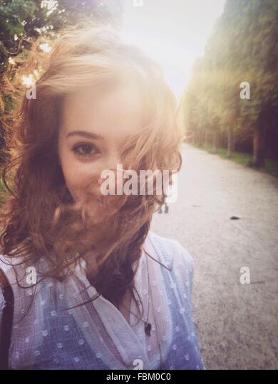 Portrait Of Beautiful Young Woman On Street - Stock Image