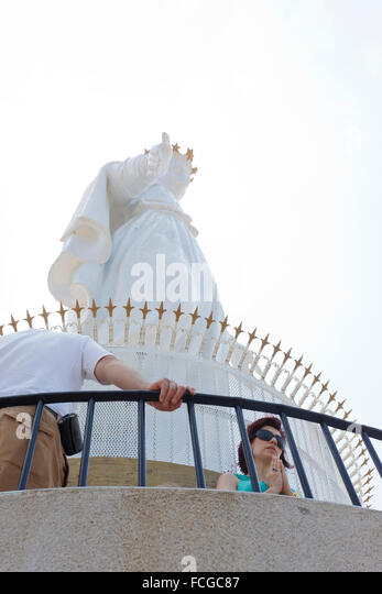 Women praying under Our Lady of Lebanon statue, Jounieh, Beirut, Lebanon - Stock Image