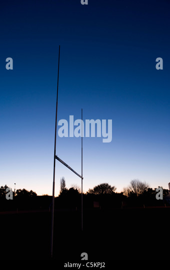 Rugby goalposts silhouetted against an evening sky, Edendale, Southland, New Zealand - Stock Image