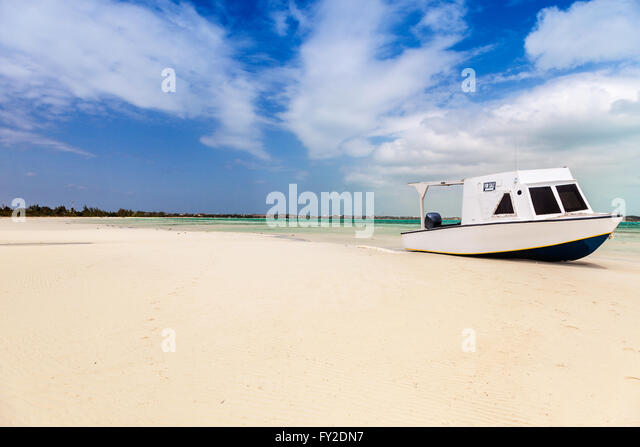 Beached boat in tropical bay - Stock Image