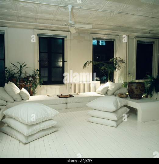 White And Black Armchairs With Contrasting Black And White Cushions In