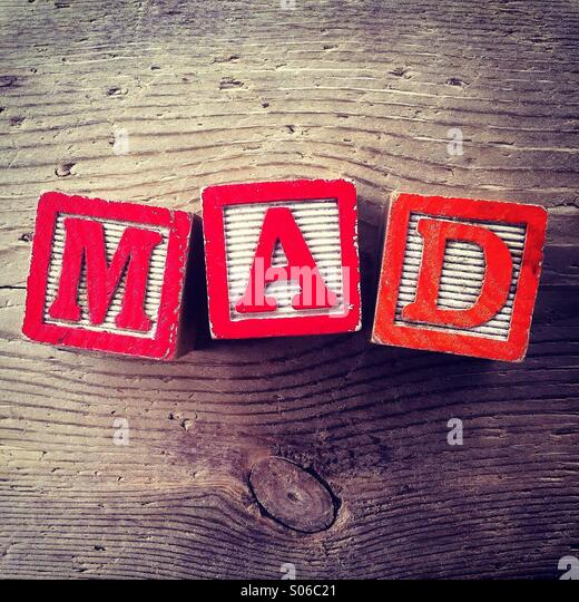 It's a photo of Woodblocks toy games with alphabet letters on them wich combine together to form the word MAD - Stock Image