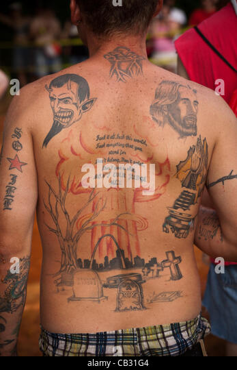 A attendee at the Red Neck Summer Games with back tattoos on May 26, 2012 in East Dublin, Georgia. - Stock-Bilder