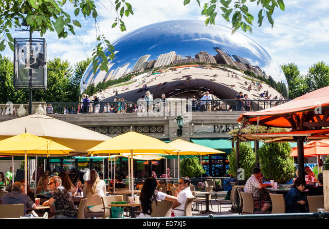 Illinois Chicago Loop Millennium Park Park Grill restaurant alfresco dining outdoor umbrellas yellow Cloud Gate - Stock Image