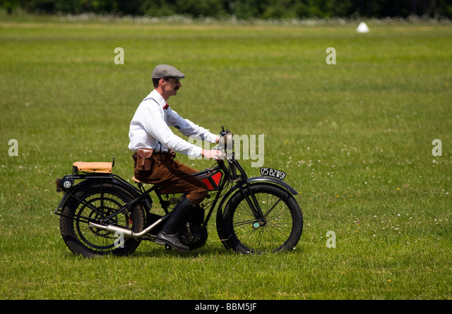 Ferte Alais vintage motorbike and rider from the epoch - Stock-Bilder