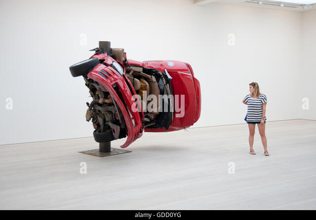 woman looks at Dirk Skreber installation at the saatchi gallery london - Stock Image