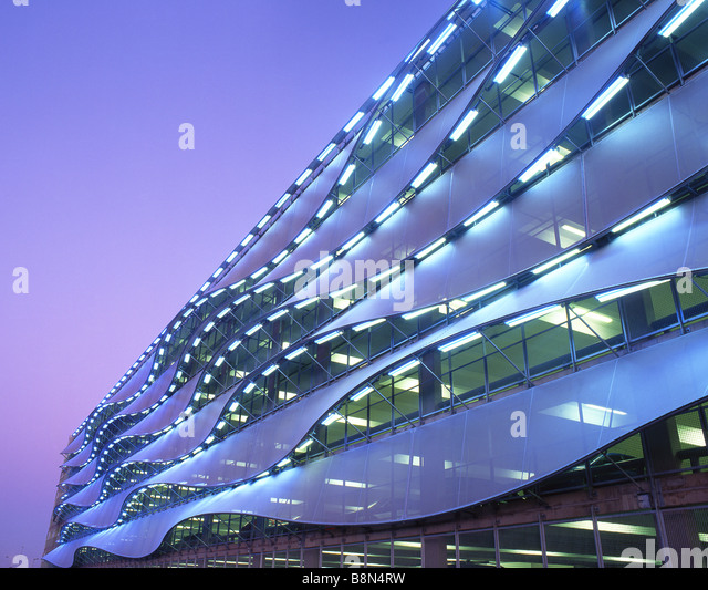 Exterior of car park at twilight dusk night Cardiff Bay Cardiff South Wales UK - Stock Image
