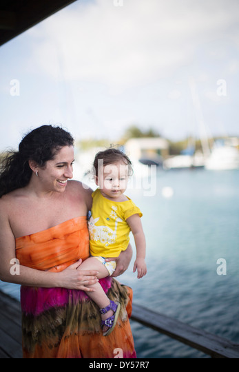 Mother and daughter by seaside - Stock Image