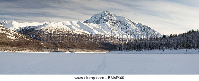 Panoramic view of Bold Peak and Eklutna Lake during Winter in Chugach State Park, Alaska - Stock Image