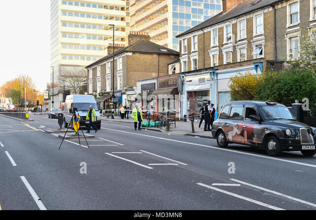London, United Kingdom. 18 April 2018. A 11-year-old boy has been injured after being hit by a vehicle on Chiswick High Road in the west london suburb of Chiswick. The London Air Ambulance landed in a nearby B&Q carpark. A section of Chiswick High Road was closed while an investigation took place causing major disruption to rush hour traffic. Credit: Peter Manning/Alamy Live News - Stock Image