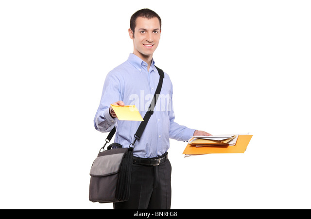 A postman delivering mail - Stock Image