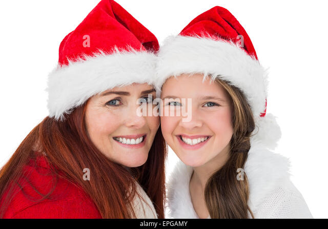Festive mother and daughter smiling at camera - Stock Image