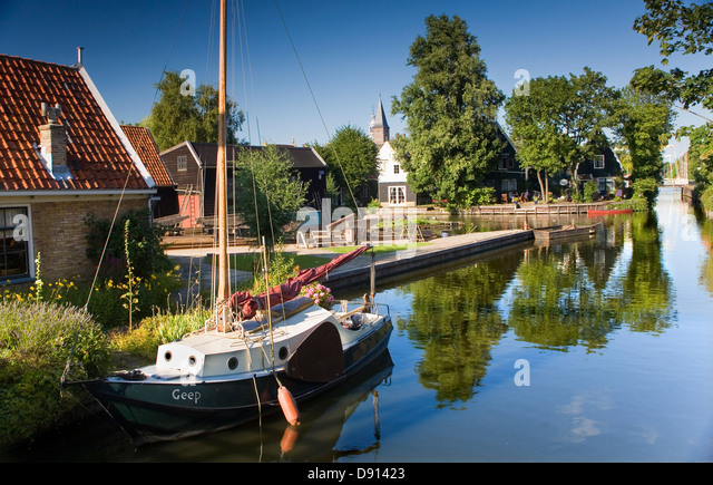 Canal with sailboat in Edam, Holland, Netherlands, Europe - Stock Image